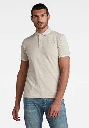 DUNDA - Poloshirt - beige