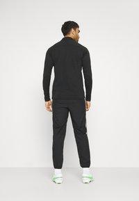 Nike Performance - DRY PANT - Spodnie treningowe - black/white - 2