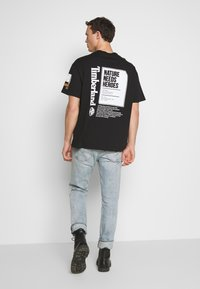 Timberland - STATEMENT PRINT TEE - Print T-shirt - black - 2