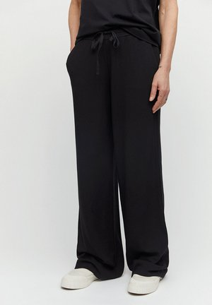 HANNAA - Trousers - black