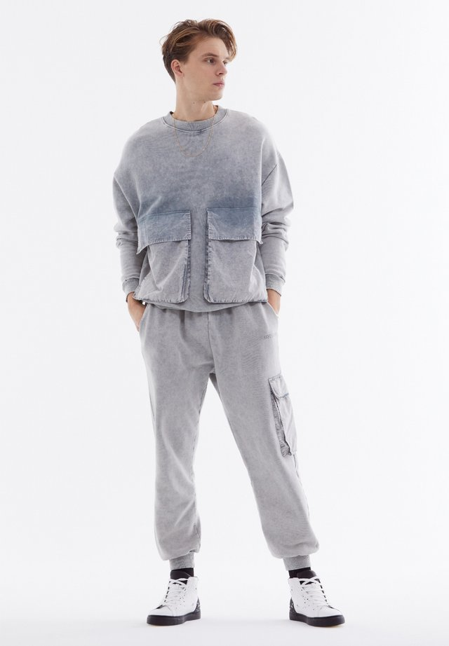 Tracksuit bottoms - mottled light blue