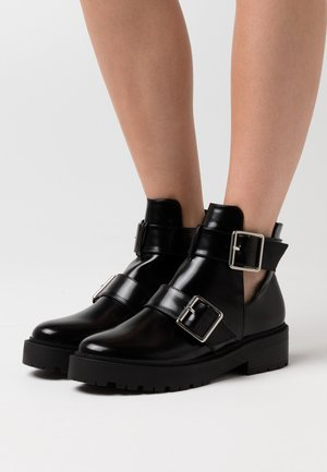 CHUNKY BUCKLE - Ankle boots - black