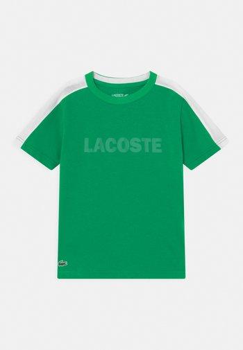 WORDING UNISEX - Print T-shirt - palm green/white
