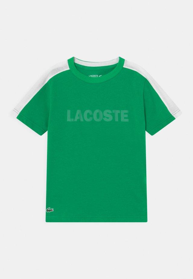 WORDING UNISEX - T-shirt med print - palm green/white
