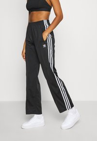 adidas Originals - FIREBIRD - Tracksuit bottoms - black - 0