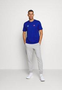 adidas Performance - SNACK PHOTO TEE - Camiseta estampada - royal blue - 1