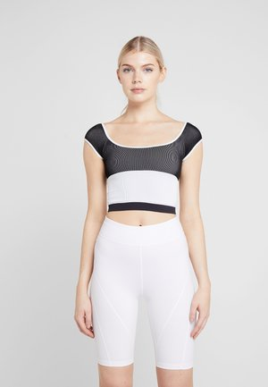 FP MOVEMENT SEAMLESS BLOCK PARTY TEE - Top - black/white