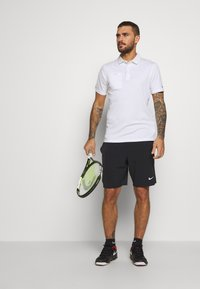 Nike Performance - ACE SHORT - Pantalón corto de deporte - black/white - 1