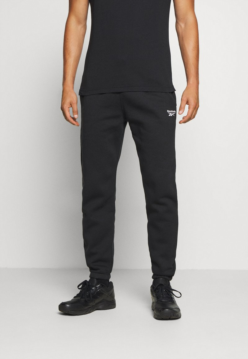 Reebok - CUFFED PANT - Pantalon de survêtement - black