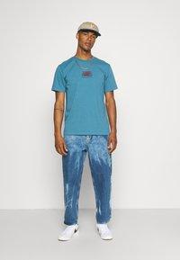 WAWWA - HARMONIA UNISEX - Print T-shirt - sky blue - 1