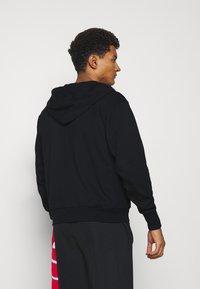 Nike Performance - ISSUE HOODIE - Zip-up sweatshirt - black/pale ivory - 2