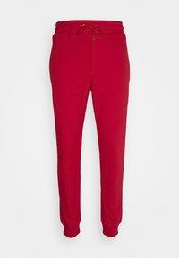 McQ Alexander McQueen - ANEIGMA - Pantaloni sportivi - red - 0