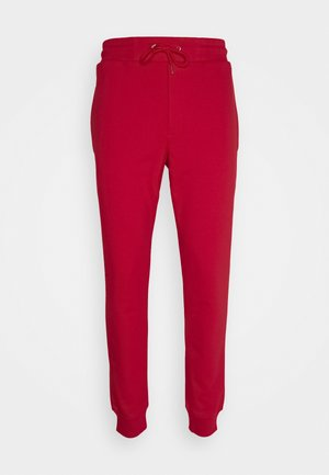 ANEIGMA - Tracksuit bottoms - red