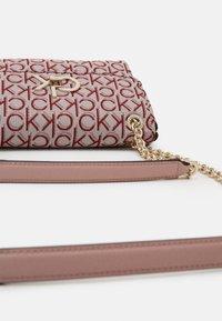 Calvin Klein - RE LOCK CROSSBODY - Across body bag - pink - 4