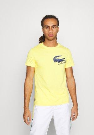 LOGO - T-shirt imprimé - sunny/navy blue