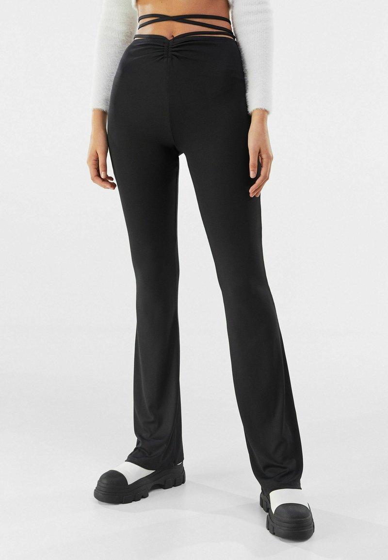 Bershka - Trousers - black