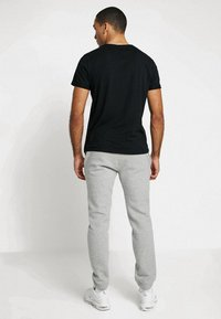 Nike Sportswear - CLUB CUFFED PANT - Tracksuit bottoms - dark grey heather/white - 2