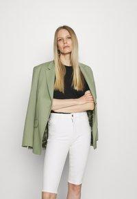 Marks & Spencer London - MAGIC - Denim shorts - white - 4