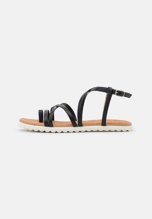 ZINNIA - T-bar sandals - black