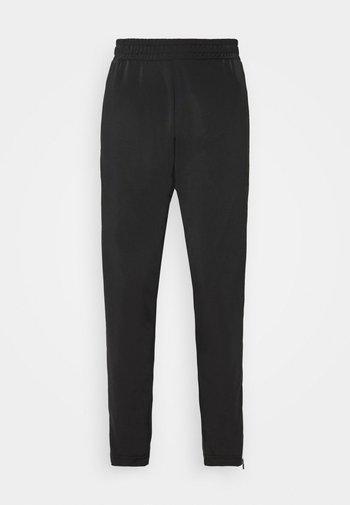 LACI PANTS - Tracksuit bottoms - black