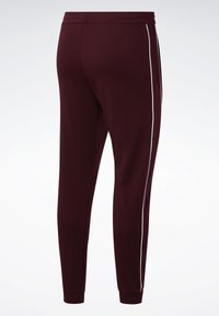 Reebok - WORKOUT READY JOGGERS - Tracksuit bottoms - burgundy - 6