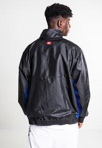 Nike Sportswear - Training jacket - black/black/rush blue/game royal - 2