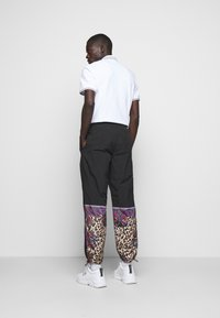 Versace Jeans Couture - CRINKLE  - Tracksuit bottoms - nero - 2