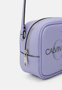 Calvin Klein Jeans - CAMERA BAG - Across body bag - lilac - 3