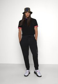 Versace Jeans Couture - ORGANIC BRUSHED - Tracksuit bottoms - black - 2
