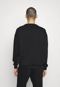 YOURTURN - UNISEX - Sweatshirt - black - 2