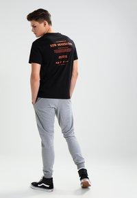 YOURTURN - Pantalones deportivos - mottled grey - 2