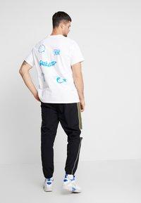 Ellesse - SERIO - Teplákové kalhoty - black - 2