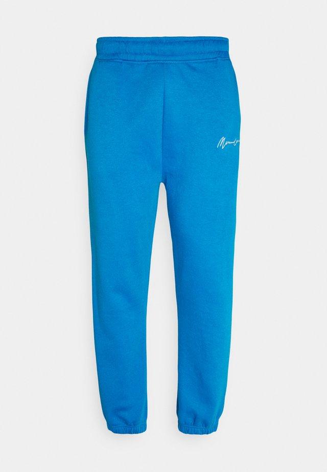 ESSENTIAL REGULAR JOGGER UNISEX - Tracksuit bottoms - blue
