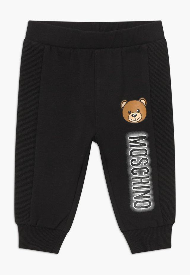 UNISEX - Trousers - black
