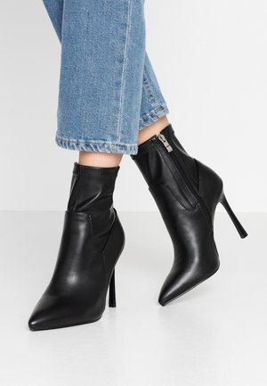 GRETA - High heeled ankle boots - black
