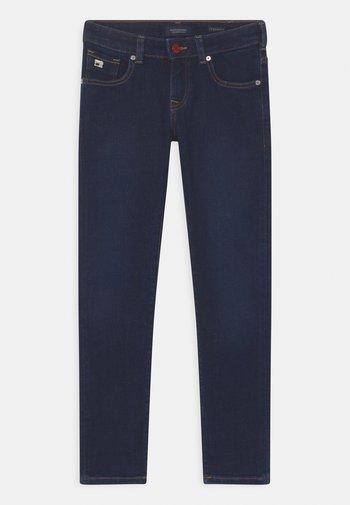 STRUMMER  - Jeans Skinny Fit - melting blau