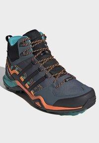 adidas Performance - TERREX SWIFT R2 MID GORE-TEX HIKING SHOES - Hiking shoes - green - 3