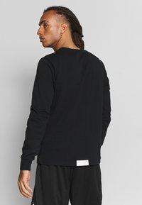 Puma - HOOPS BOUNCE TEE - Långärmad tröja - black - 2