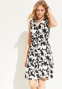 comma - Jersey dress - black floral print - 0
