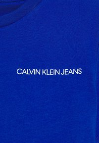 Calvin Klein Jeans - CHEST LOGO - T-shirt basic - blue