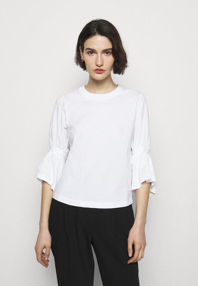 Long sleeved top - white powder