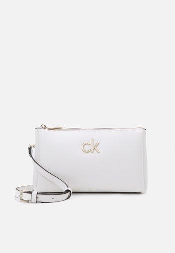 XBODY ZIP - Across body bag - white