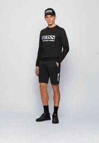 BOSS - HEADLO - Shorts - black - 1