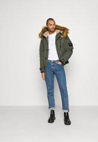 Diesel - W-JAME JACKET - Winter jacket - olive - 1