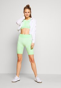 ONLY Play - ONPMASHA LIFE CIRCULAR SHORTS - Leggings - green ash - 1