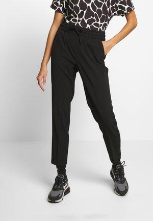 STRING PANTS  - Trousers - black
