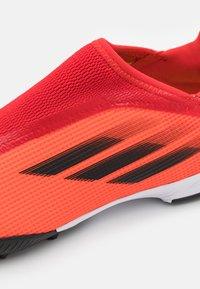 adidas Performance - X SPEEDFLOW.3 LL TF UNISEX - Kopačky na umělý trávník - red/core black/solar red - 5