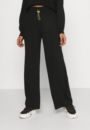 TOGGLE - Trousers - black