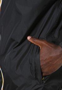 K-Way - LE VRAI CLAUDE UNISEX - Waterproof jacket - black - 5