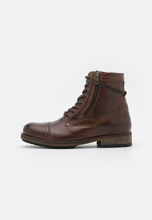 MELTING HIGH - Classic ankle boots - cognac